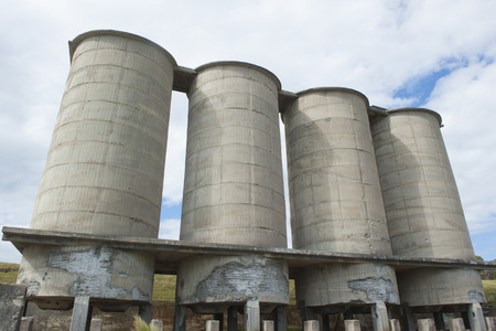 industrial heritage: Old abandoned silos of industrial site on Maria Island Tasmania Australia now protected National Park and World Heritage Site. Stock Photo