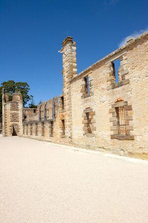 gaol: World Heritage Site of  Port Arthur Convict Museum Settlement in Tasmania, Australia, with ruin of historic prison building, tourist attraction, blue sky. Editorial