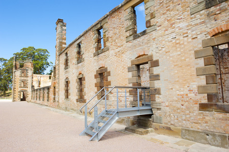 relict: World Heritage Site of  Port Arthur Convict Museum Settlement in Tasmania, Australia, with relict of historic prison building, tourist attraction, blue sky. Redactioneel