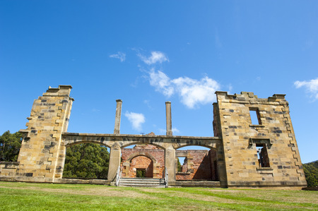 gaol: World Heritage Site of  Port Arthur Convict Museum Settlement in Tasmania, Australia, with ruins of historic hospital building, tourist attraction, blue sky copy space. Editorial