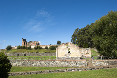 gaol: World Heritage Site of  Port Arthur Convict Museum Settlement in Tasmania, Australia, with ruins of historic prison and other buildings, tourist attraction, blue sky, copy space.