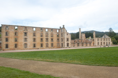 relict: World Heritage Site of  Port Arthur Convict Museum Settlement in Tasmania, Australia, with ruins of historic prison and other buildings, tourist attraction and destination.