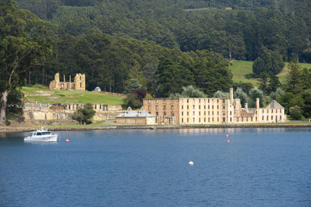 penal: World Heritage Site of former Penal Convict Settlement Port Arthur on Tasmania, Australia, with ruin of prison at water of harbour and other old buildings.