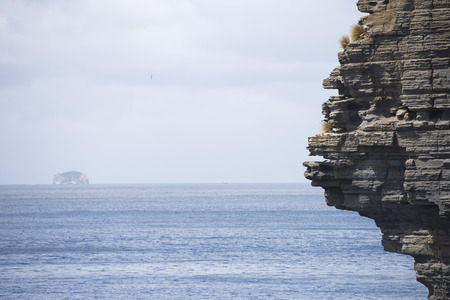 steep cliffs: Rough steep cliffs along Tasmanian coastline close to Port Arthur in Tasman Peninsula National Park, Australia Stock Photo