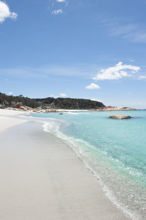 Beautiful white beach with turquoise clear water of Pacific Ocean at Bay of Fires near St Helens photo