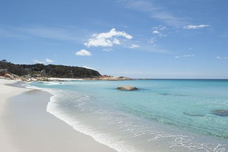 helens: Beautiful white beach with turquoise clear water of Pacific Ocean at Bay of Fires near St Helens, popular holiday destination, copy space. Stock Photo
