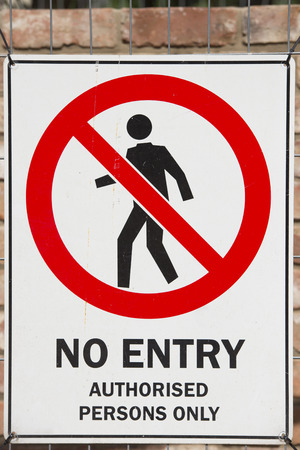 No entry sign on construction site fence to indicate restricted access to private property for security reason Stock Photo