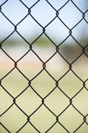 enclosing: Close up texture of Security mesh fence enclosing private property