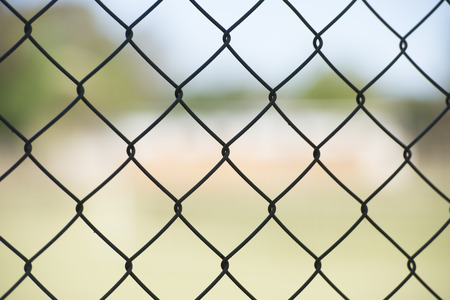 security gap: Close up of Security mesh fence as barrier for private property or prison