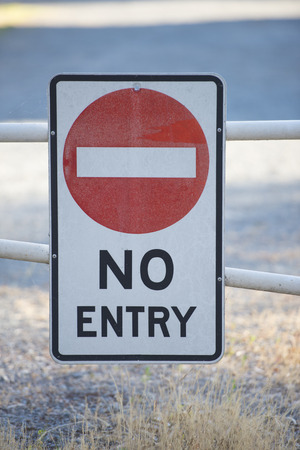 restricted area: No entry sign on gate to restricted area of private property in blurred background Stock Photo