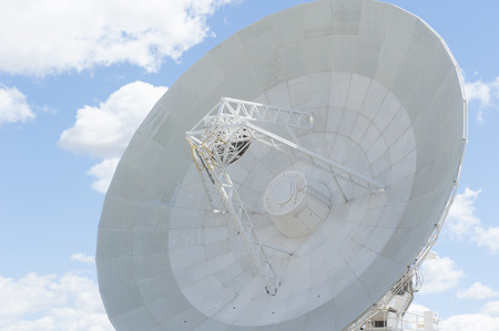 outback australia: Big modern telescope dish for astronomical scientific research standing in outback Australia, searching the universe for galaxies, stars and planets, with blue sky and clouds as background and copy space.