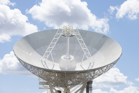 outback australia: Construction of telescope dish in outback Australia for astronomical science, research and search for other planets, galaxies and sign of life in the universe, with blue sky and clouds as background and copy space.