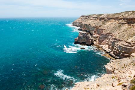 Beautiful Aerial panorama of rugged rock cliff coast formation of Kalbarri National Park in Western Australia, wild sea of Indian Ocean, blue sky, horizon, copy space. Stock Photo
