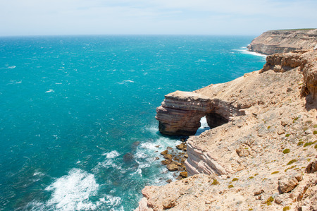 western australia: Beautiful Aerial panorama of  rugged rock cliff coast formation of Kalbarri National Park in Western Australia, wild sea of Indian Ocean, blue sky, horizon, copy space. Stock Photo