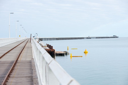 southern indian: Historic Busselton Jetty in Western Australia, longest timber pier in the Southern Hemisphere, railway line, scenic Indian Ocean. Stock Photo