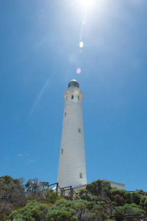 southern indian: Sun flare at Cape Leeuwin Lighthouse, near Augusta, Western Australia, where Southern and Indian Ocean meet.