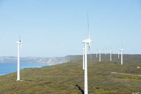 renewable energy: Wind farm at coast of Southern Ocean in Western Australia, supplying renewable energy to town of Albany, summer sunny blue sky, copy space.