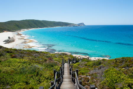 Scenic panoramic view of cliff coast and Cable Beach at Torndirrup National Park, Albany, Western Australia, wild Southern Ocean, blue sky, copy space.