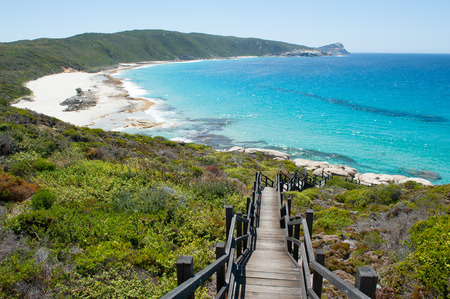 Scenic panorama of cliff coast and Cable Beach at Torndirrup National Park, Albany, Western Australia, wild Southern Ocean, blue sky, copy space. Stock Photo