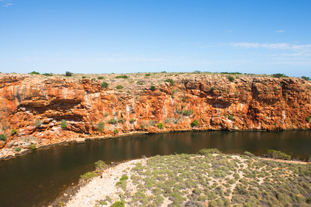 aerial view: Aerial view of Yardie Creek river in Cape Range National Park, Exmouth, Western Australia, sunny blue sky, copy space. Stock Photo
