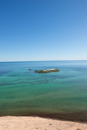 shark bay: Beautiful aerial view of Eagles Bluff at Shark Bay in Western Australia, clear ocean, summer sunny blue sky, horizon, copy space.