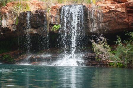 the outback: Beautiful waterfall at  Ferntree Pool in Karijini National Park in outback Pilbara of Western Australia. Stock Photo