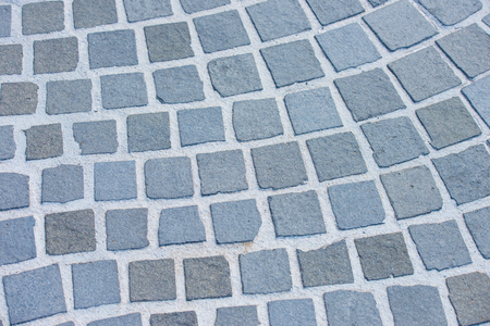 rough road: Detail of path, walkway or street and road with rough square cobble stone pavement as textured backdrop or pattern design background, copy space. Stock Photo