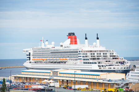 Fremantle, Western Australia - February 12, 2017: Cruise ship Queen Mary II anchored in Port of Fremantle, Western Australia, with overview of city and the ocean in background. Editorial
