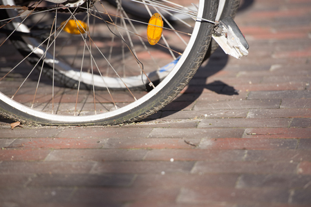 space weather tire: Close up flat tyres of parked bicycles in city. Stock Photo