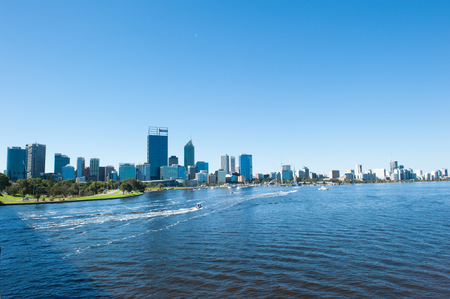 April 2, 2017: Scenic skyline of Perth, capital of Western Australia at the Swan River, with many people spending their free time on or at the water. Editorial