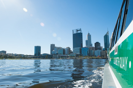 perth: April 2, 2017: Scenic skyline of Perth, capital of Western Australia at the Swan River regional headquarter for mining, finance and insurance companies, with view from ferry approaching Elizabeth Quay.