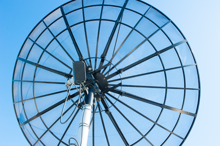 Satellite dish against blue sky, for modern wireless communication and data transmission, copy space. Stock Photo