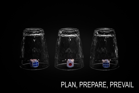 Plan, prepare, prevail. Closeup view of three overturned shot glasses with dices, tiles or dies inside each glass. Isolated against black background. Missing Impossible!