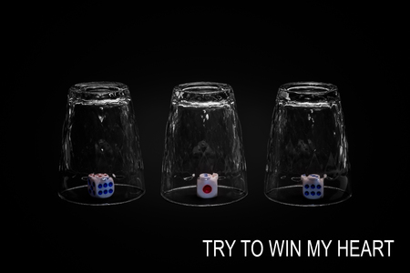 Try and win my heart. Closeup view of three overturned shot glasses with dices, tiles or dies inside each glass. Isolated against black background. Missing Impossible! Stock Photo