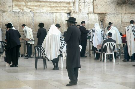 Hebrew Men engaged in ritual prayer at the Wailing Wall, also know as the Western Wall, in Jerusalem, Israel