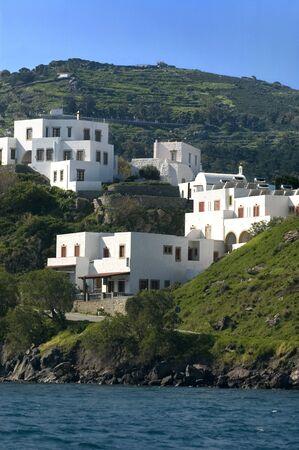 White houses on the shoreline of the Island of Patmos, Greece Foto de archivo