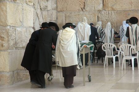Men at the Wailing Wall, also know as the Western Wall, in Jerusalem, Israel