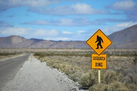 A comical traffic sign in the desert warning of sasquatch crossing