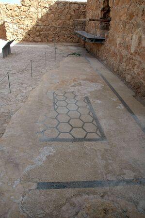 Ruins of a floor mosaic in the Palace of King Herod in Masada, Israel Foto de archivo