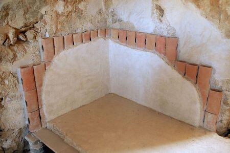 Ruins of a Roman heating system in a room called a caldarium in Masada, Israel Foto de archivo