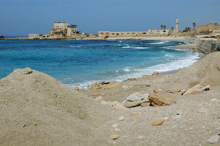 The Mediterranean coast at the Ancient Port Caesarea Maritima, Israel Foto de archivo