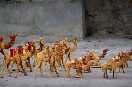 A caravan of wooden souvenir camels for sale by a local vendor in Jerusalem, Israel