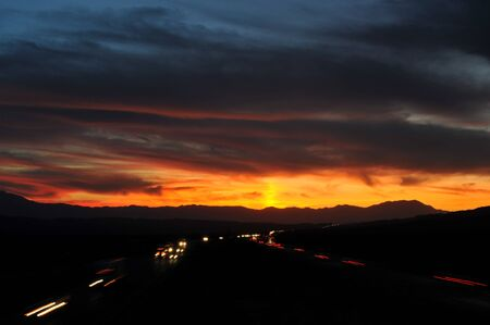 Truckers leaving streaks of light on Interstate 10 headed into the sunset toward Indio, Ca