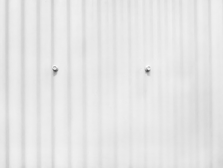 white metal sheet with bolt,corrugated zinc wall texture Stock Photo