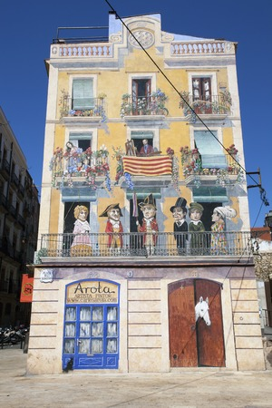 editorial photos at home in Tarragona with a fake painted facade, filmed in Spain in 2012