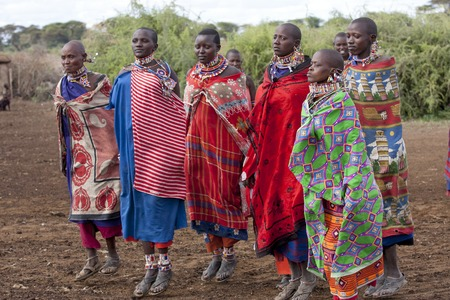 Editorial Photo Masai women dressed in national clothes and jumping in traditional dance, January 2009, Amboseli, Kenya