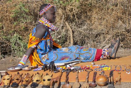 Editorial photo of a beautiful young woman of the tribe Maasai in national costume selling souvenirs, Amboselli January 2009, Kenya