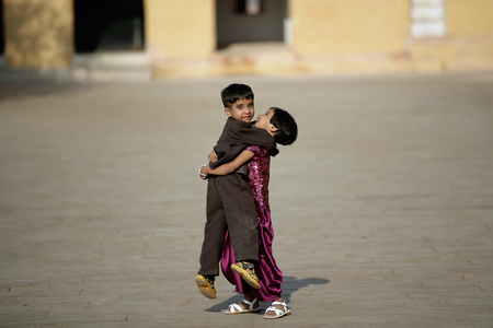 Editorial Photo happy boy and girl playing in the courtyard of Amber Fort in Jaipur, India 2009 에디토리얼
