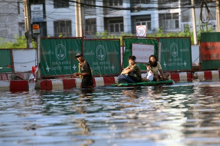 Thailand, Bangkok - November 2011: local residents during floods get to swim in a hospital, Bangkok