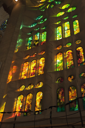 Spain, Barcelona - July 2012: Sagrada Familia, the reflections of the windows on the walls